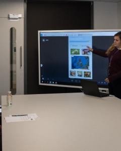 Students present their mobile app solution to an industry partner