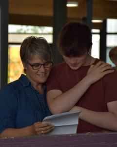 Dan Stacey celebrates excellent results with his mum